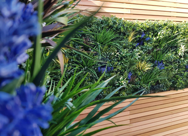 cedar battens with artificial green wall panels