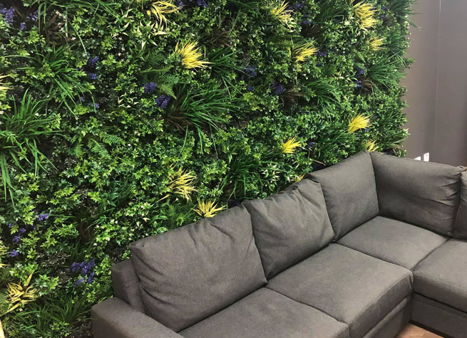 interior green wall with comfy sofas