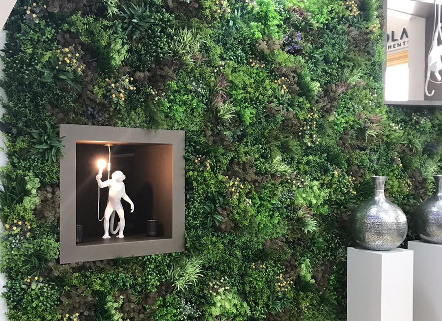 artificial green wall displaying artwork
