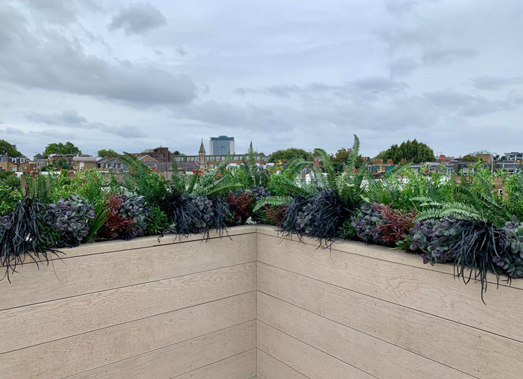 rooftop terrace embelished with artificial plants